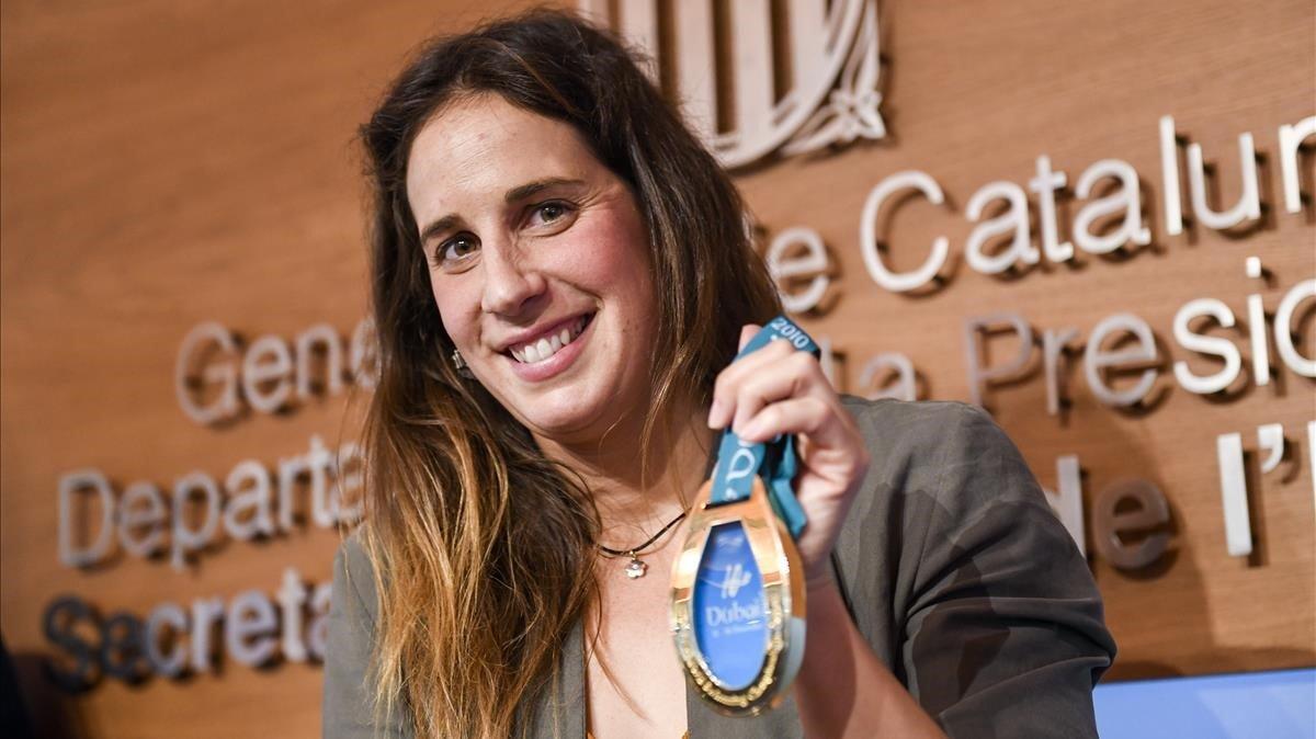 Erika Villaécija, con el oro del Mundial de Dubái del 2010 en piscina corta.
