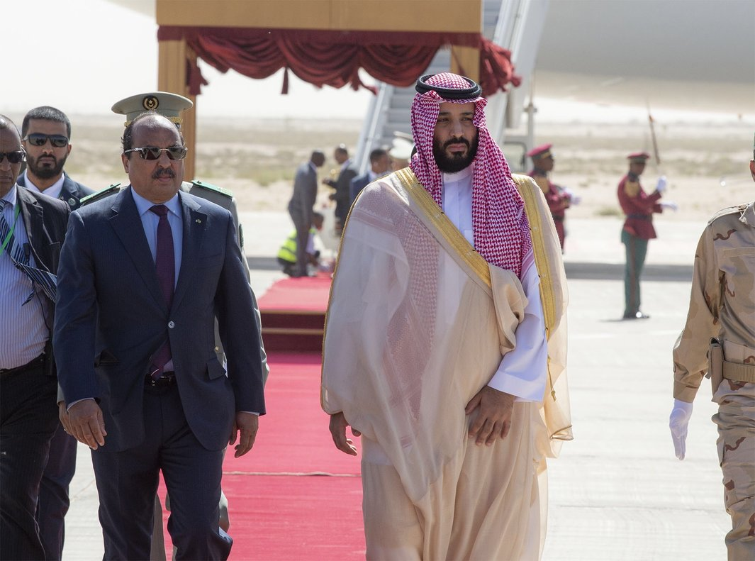 Mauritanian President Mohamed Ould Abdel Aziz  greets Saudi Arabia s Crown Prince Mohammed bin Salman at his arrival at Nouakchott International Airport Photo by Bandar AL-JALOUD   Saudi Royal Palace   AFP