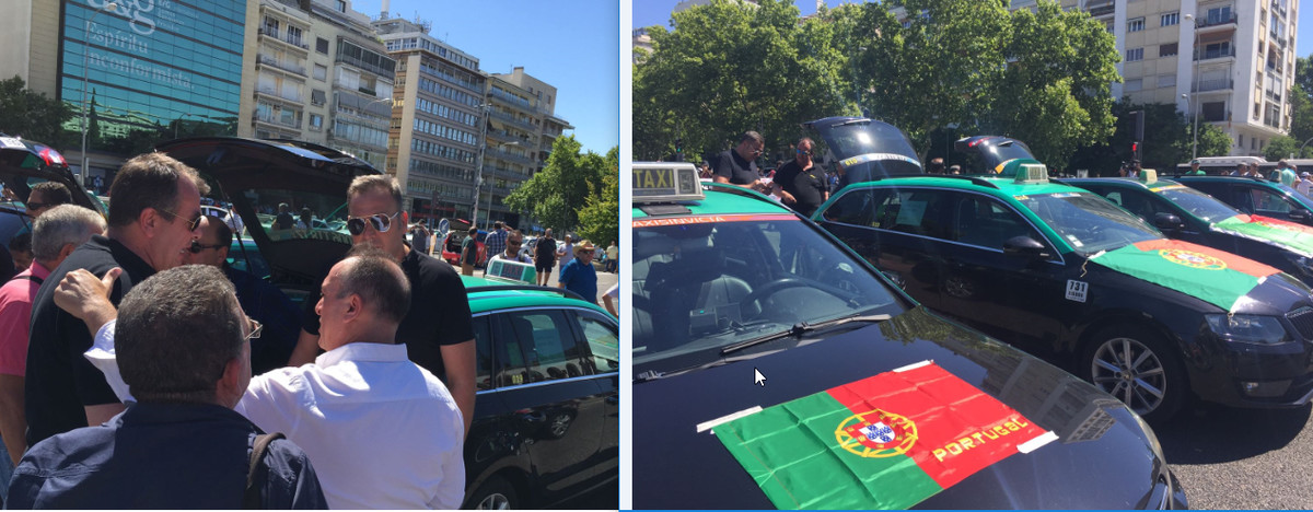 Cuatro taxis portugueses se han unido a la concentración de taxistas ante el Ministerio de Fomento, en el Paseo de la Castellana de Madrid. En la imagen, recibimiento de los madrileños a sus colegas.