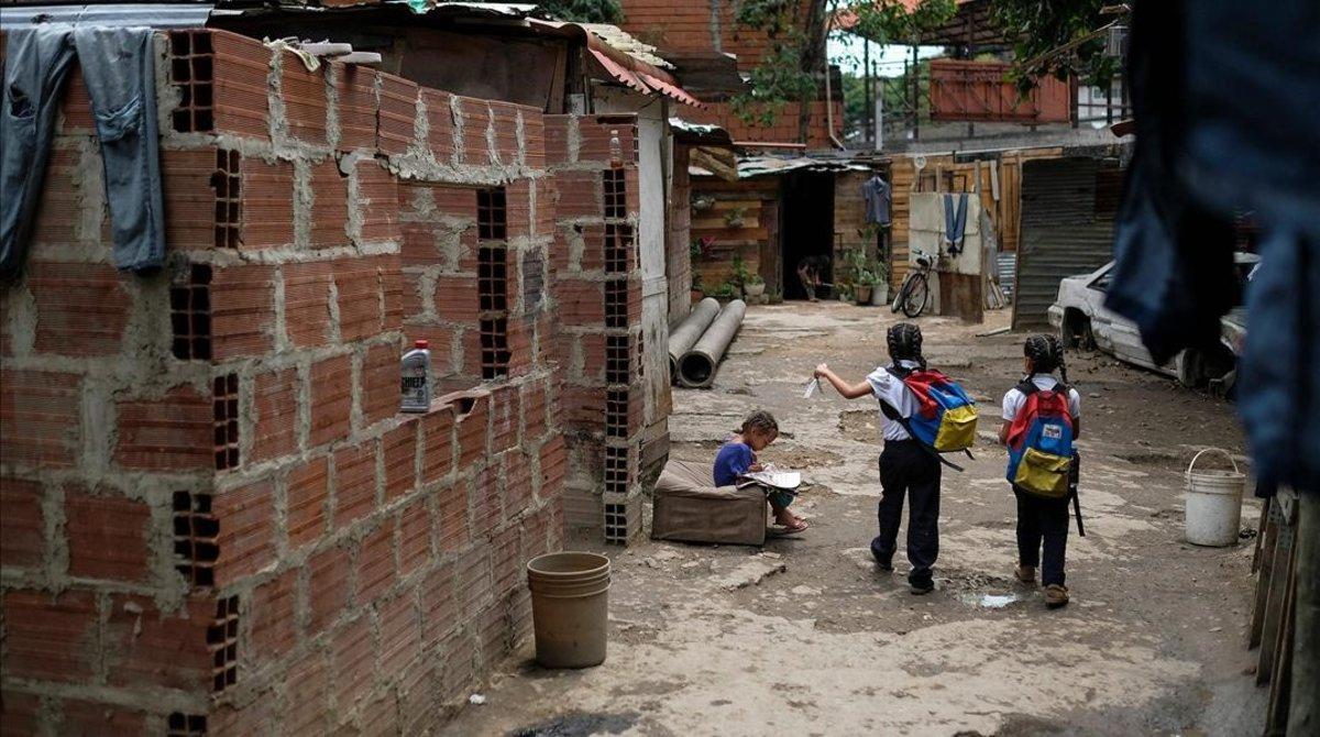 Unos niños en el barrio de Petare, en Caracas.