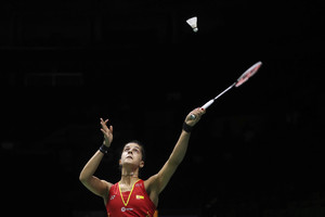 Carolina Marin of Spain plays a shot as she competes against Saina Nehwal of India in their women's badminton singles quarterfinal match at the BWF World Championships in Nanjing, China, Friday, Aug. 3, 2018. (AP Photo/Mark Schiefelbein)