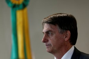 FILE PHOTO Brazil s President-elect Jair Bolsonaro gestures during a meeting at Superior Labor Court in Brasilia Brazil November 13 2018 REUTERS Adriano Machado - RC1876A15990 File Photo