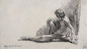 Hombre desnudo sentado en el suelo.La misma habilidad que demostró sobre la tela la demostró sobre el papel.