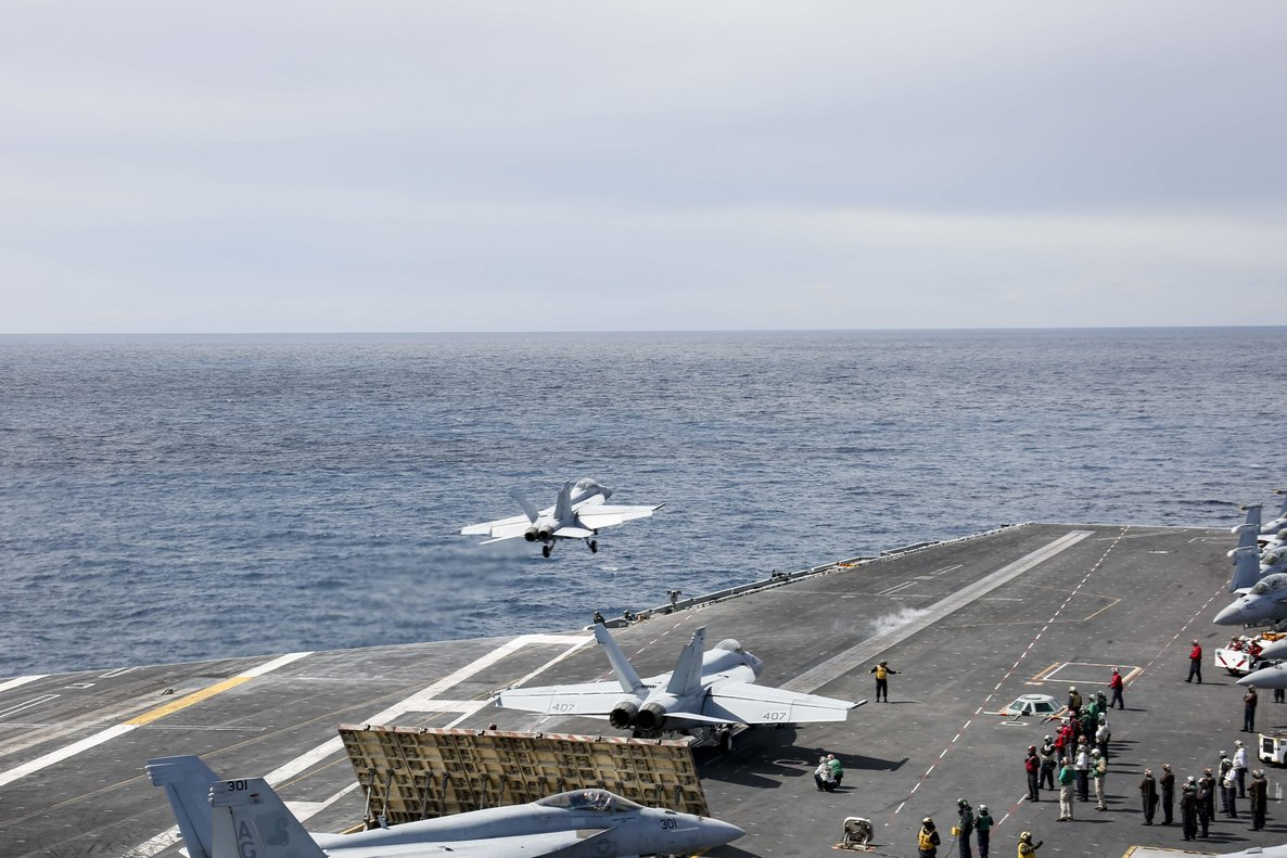 Ionian Sea (-), 06/05/2019.- A handout photo made available by the US Navy showing an F/A-18F Super Hornet from the 'Jolly Rogers' of Strike Fighter Squadron (VFA) 103 launching off the flight deck of the Nimitz-class aircraft carrier USS Abraham Lincoln (CVN 72) to conduct a close air support exercise together with the US Air Force 603rd Air Control Squadron and the Lithuanian Air Force on 06 May 2019. The Abraham Lincoln Carrier Strike Group (ABECSG) is deployed to the US Central Command area of responsibility in order to defend American forces and interests in the region. Media reports on 13 May 2019 state that the United Arab Emirated (UAE) Foreign Office report that four commercial vessels have been targeted by sabotage operations near UAE territorial waters. (Lituania) EFE/EPA/US NAVY / DVIDS / HANDOUT HANDOUT EDITORIAL USE ONLY/NO SALES