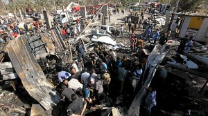 kamor33073673 residents gather at the site of a bomb attack at a160306151307