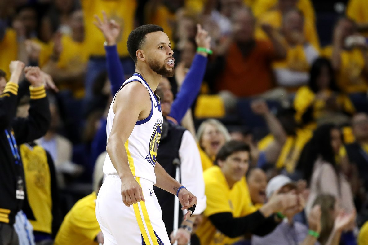 OAKLAND, CALIFORNIA - MAY 14: Stephen Curry #30 of the Golden State Warriors reacts to a shot during the second half against the Portland Trail Blazers in game one of the NBA Western Conference Finals at ORACLE Arena on May 14, 2019 in Oakland, California. NOTE TO USER: User expressly acknowledges and agrees that, by downloading and or using this photograph, User is consenting to the terms and conditions of the Getty Images License Agreement. Ezra Shaw/Getty Images/AFP