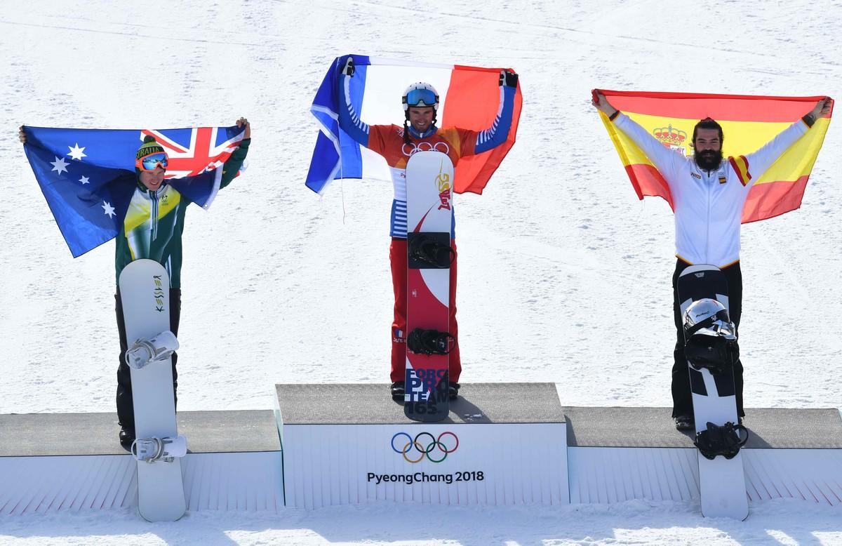 Regino Hernández, en el podio, junto al francés Vaultier (centro) y el australiano Hughes.