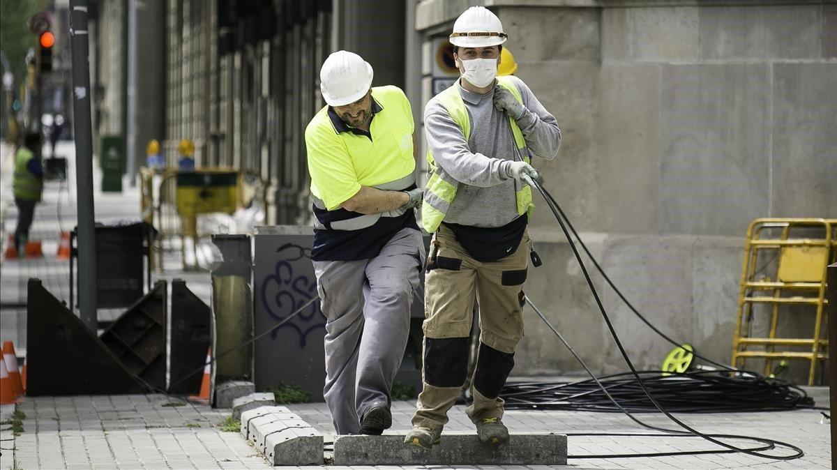 Trabajadores de la construcción y la obra pública, en Barcelona.