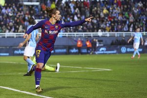 Antoine Griezmann celebrando el tanto de la victoria en el añadido