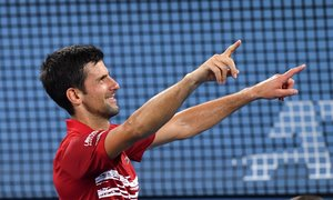 Brisbane (Australia), 06/01/2020.- Novak Djokovic of Serbia celebrates after winning the doubles match with partner Viktor Troicki against Edouard Roger-Vasselin and Nicolas Mahut of France during day 4 of the ATP Cup tennis tournament at Pat Rafter Arena in Brisbane, Australia, 06 January 2020. (Tenis, Francia) EFE/EPA/DARREN ENGLAND AUSTRALIA AND NEW ZEALAND OUT EDITORIAL USE ONLY