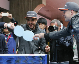 McLaren driver Fernando Alonso, left, of Spain and Renault driver Nico Hulkenberg of Germany play a table tennis ahead of the Chinese Formula One Grand Prix at the Shanghai International Circuit in Shanghai, China, Sunday, April 9, 2017. (AP Photo/Toru Takahashi)