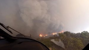 A helicopter takes off after a rescue made on the fly during the Woolsey Fire in Malibu California in this November 9 2018 still image taken from helmet camera footage by LAFD David Nordquist LAFD David Nordquist Social Media via REUTERS ATTENTION EDITORS - THIS PICTURE WAS PROVIDED BY A THIRD PARTY NO RESALES NO ARCHIVE MANDATORY CREDIT