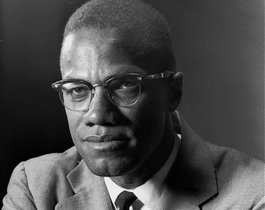 ** FILE ** Malcolm X, the Black Muslim leader, is photographed in New York on March 5, 1964. Malcom X was assassinated in 1965 and 32 years later his wife Betty Shabazz was killed in a fire set by their grandson, Malcolm's namesake. Ilyasah Shabazz, says she and her five sisters don't want pity and, in fact, had a sheltered upbringing. Ilyasah says in her new memoir, Growing Up X, that people are surprised when they learn how normal my childhood was, how mainstream and privileged and integrated and utterly American. (AP Photo/Eddie Adams)