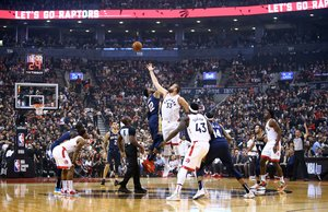 TORONTO, ON - OCTOBER 22: Marc Gasol #33 of the Toronto Raptors contests the opening tip off with Derrick Favors #22 of the New Orleans Pelicans during the first half of an NBA game at Scotiabank Arena on October 22, 2019 in Toronto, Canada. NOTE TO USER: User expressly acknowledges and agrees that, by downloading and or using this photograph, User is consenting to the terms and conditions of the Getty Images License Agreement. Vaughn Ridley/Getty Images/AFP
