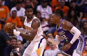 PHOENIX, ARIZONA - OCTOBER 23: Deandre Ayton #22 of the Phoenix Suns looks to pass under pressure from Richaun Holmes #22 of the Sacramento Kings during the first half of the NBA game at Talking Stick Resort Arena on October 23, 2019 in Phoenix, Arizona. NOTE TO USER: User expressly acknowledges and agrees that, by downloading and/or using this photograph, user is consenting to the terms and conditions of the Getty Images License Agreement Christian Petersen/Getty Images/AFP