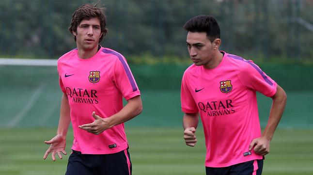 Sergi Roberto y Munir, durante un entrenamiento en la ciudad deportiva del Barça.