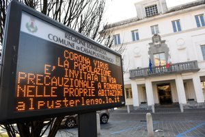 A sign warning people to stay at home is seen in the town of Casalpusterlengo amid a coronavirus outbreak in northern Italy, February 22, 2020. REUTERS/Flavio Lo Scalzo