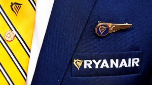 FILE PHOTO: Ryanair logo is pictured on the the jacket of a cabin crew member ahead of a news conference by Ryanair union representatives in Brussels, Belgium September 13, 2018. REUTERS/Francois Lenoir/File Photo
