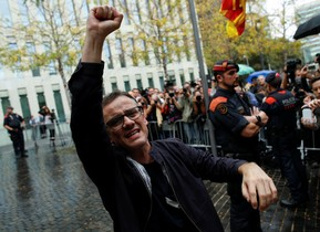 Catalan Junior Economy Minister Josep Maria Jove raises his arm after he was released in Barcelona Spain September 22 2017 REUTERS Jon Nazca