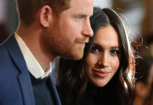FILED - 13 February 2018, England, London: Prince Harry (L) and his wife Meghan, the Duke and Duchess of Sussex. Britain's Prince Harry and his wife Meghan are no longer working members of the Royal Family,Buckingham Palace said in a statement released late Saturday. Photo: Andrew Milligan/PA Wire/dpa