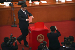Chinese President Xi Jinping places his ballot in a ballot box during a plenary session of Chinas National Peoples Congress (NPC) at the Great Hall of the People in Beijing, Sunday, March 11, 2018. Chinas rubber-stamp lawmakers on Sunday passed a historic constitutional amendment abolishing presidential term limits that will enable Xi to rule indefinitely. (AP Photo/Mark Schiefelbein)