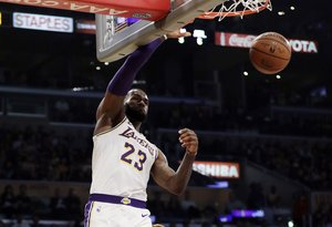 Los Angeles Lakers' LeBron James (23) dunks against the Atlanta Hawks during the first half of an NBA basketball game Sunday, Nov. 11, 2018, in Los Angeles. (AP Photo/Marcio Jose Sanchez)