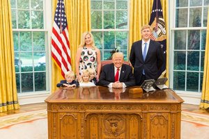 U S President Donald Trump and Vice President s Chief of Staff Nick Ayers R and his wife Jamie Floyd with their children pose for pictures in the Oval Office at the White House in this social media photo released by Vice President Mike Pence s office in Washington DC U S on July 28 2017 Courtesy Vice President s office Handout via REUTERS ATTENTION EDITORS - THIS IMAGE HAS BEEN SUPPLIED BY A THIRD PARTY