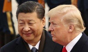 El presidente de China, Xi Jinping, y de EEUU, Donald Trump, durante un encuentro en Pekín.