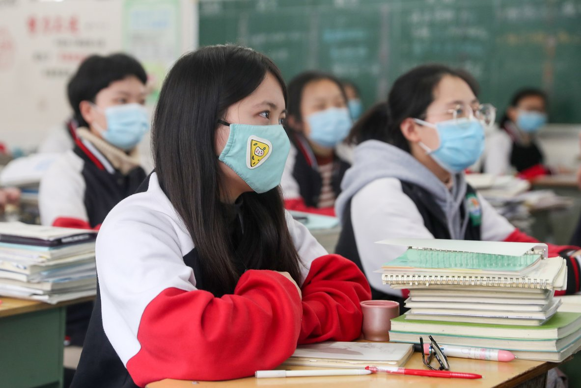 09 April 2020, China, Chongqing: High school grade students wearing face masks attend a class after the term opening was delayed due to the Coronavirus (Covid-19) outbreak. Photo: -/SIPA Asia via ZUMA Wire/dpa