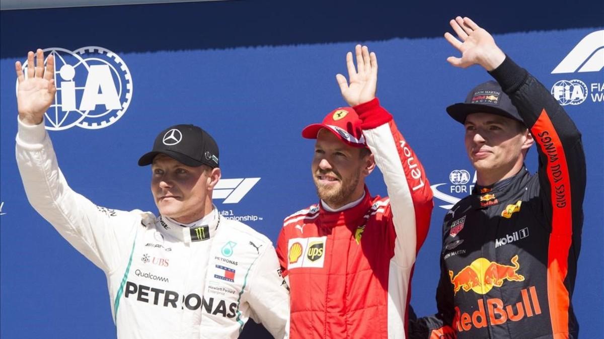 Sebastian Vettel ha logrado hoy la pole en Canadá, siendo más veloz que Valtteri Bottas, a la izquierda, y Max Verstappel, a la derecha.