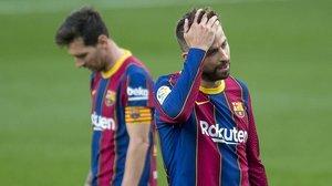 Leo Messi y Gerard Piqué, en el clásico.