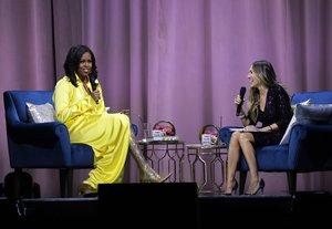 Michelle Obama y Sara Jessica Parker, durante la presentación del libro de memorias de la exprimera dama.