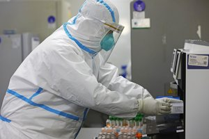 SHANGHAI, CHINA - APRIL 30: A researcher wearing a protective suit prepares nucleic acid tests at Shanghai Labway Clinical Laboratory on April 30, 2020 in Shanghai, China. (Photo by Yin Liqin/China News Service via Getty Images)