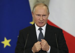 Russian President Vladimir Putin speaks during a joint news conference  in the Kremlin in Moscow  Russia  Photo via AP