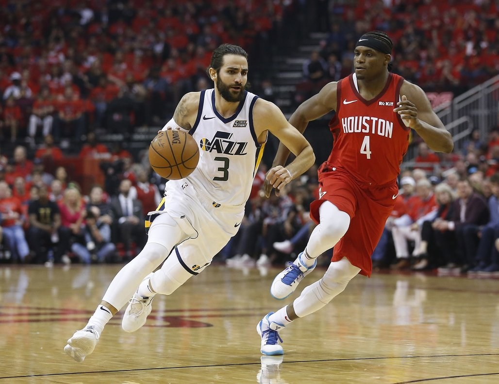 HOUSTON, TEXAS - APRIL 14: Ricky Rubio #3 of the Utah Jazz drives around Danuel House Jr. #4 of the Houston Rockets in the first quarter during Game One of the first round of the 2019 NBA Western Conference Playoffs between the Houston Rockets and the Utah Jazz at Toyota Center on April 14, 2019 in Houston, Texas. NOTE TO USER: User expressly acknowledges and agrees that, by downloading and or using this photograph, User is consenting to the terms and conditions of the Getty Images License Agreement. Bob Levey/Getty Images/AFP