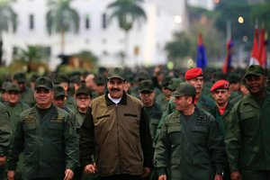 Venezuela s President Nicolas Maduro smiles as he walks next to Venezuela s Defense Minister Vladimir Padrino Lopez and Remigio Ceballos Strategic Operational Commander of the Bolivarian National Armed Forces during a ceremony at a military base in Caracas Venezuela May 2 2019 Miraflores Palace Handout via REUTERS ATTENTION EDITORS - THIS PICTURE WAS PROVIDED BY A THIRD PARTY