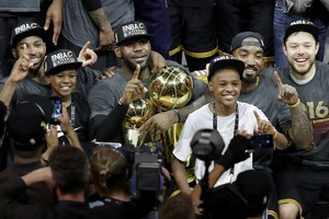 OAKLAND, CA - JUNE 19: LeBron James #23 of the Cleveland Cavaliers celebrates with his sons LeBron Jr. and Bryce after defeating the Golden State Warriors 93-89 in Game 7 of the 2016 NBA Finals at ORACLE Arena on June 19, 2016 in Oakland, California. NOTE TO USER: User expressly acknowledges and agrees that, by downloading and or using this photograph, User is consenting to the terms and conditions of the Getty Images License Agreement. Ronald Martinez/Getty Images/AFP