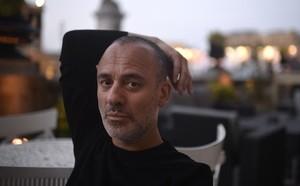 El actor espanol Javier Gutierrez posa en la terraza del Hotel Maria Cristinadurante el festival de cine de San Sebastián.