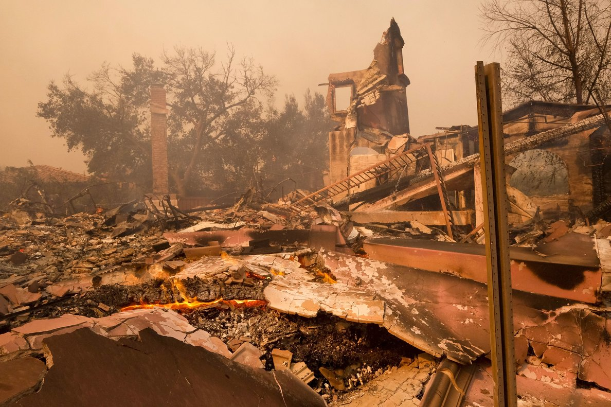 Photo shows the charred remains of a home after the Woolsey fire swept through Malibu  Calif  The number of structures destroyed by a huge Southern California wildfire has risen to 1 500  Another 341 structures were damaged as of a Monday As firefighters mop up  repair and restoration of utilities is continuing along with repopulation of areas evacuated when winds spread the fire earlier this month  Forecasters predict rain in the area by midweek   AP Photo Ringo H W  Chiu  File