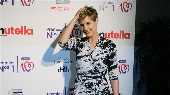 La presentadora Tania Llasera posa en la Gala de premios Cadena 100 en el hotel Grand Marina de Barcelona, en mayo del2014.