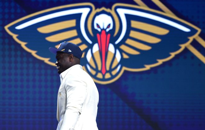 NEW YORK NEW YORK - JUNE 20 Zion Williamson walks to the stage after being drafted with the first overall pick by the New Orleans Pelicans during the 2019 NBA Draft at the Barclays Center on June 20 2019 in the Brooklyn borough of New York City NOTE TO USER User expressly acknowledges and agrees that by downloading and or using this photograph User is consenting to the terms and conditions of the Getty Images License Agreement Sarah Stier Getty Images AFP FOR NEWSPAPERS INTERNET TELCOS TELEVISION USE ONLY