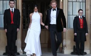 Enrique y Meghan Markle, el sábado por la tarde. Ella con un segundo vestido de novia de Stella McCartney.