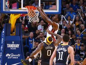 Feb 10, 2019; Oakland, CA, USA; Miami Heat center Bam Adebayo (13) dunks the ball above Golden State Warriors center DeMarcus Cousins (0) during the fourth quarter at Oracle Arena. Mandatory Credit: Kelley L Cox-USA TODAY Sports