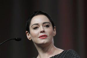 FILE- In this Oct. 27, 2017, file photo, actress Rose McGowan speaks at the inaugural Women's Convention in Detroit. McGowan has filed a federal lawsuit alleging that Harvey Weinstein and two of his former attorneys engaged in racketeering to silence her and shut down her career before she accused Weinstein of rape. (AP Photo/Paul Sancya, File)