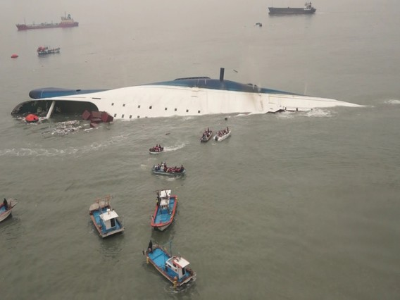 South Korean ferry Sewol is seen sinking in the sea off Jindo April 16, 2014, in this picture provided by Korea Coast Guard and released by Yonhap. Almost 300 people were missing after a ferry sank off South Korea on Wednesday, the coastguard said, in what could be the country's biggest peacetime disaster in nearly 20 years. REUTERS/Korea Coast Guard/Yonhap