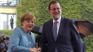 El presidente del Gobierno y la canciller alemana, a su llegada a la reunión de jefes de Estado y de Gobierno de la UE de los miembros del G20.