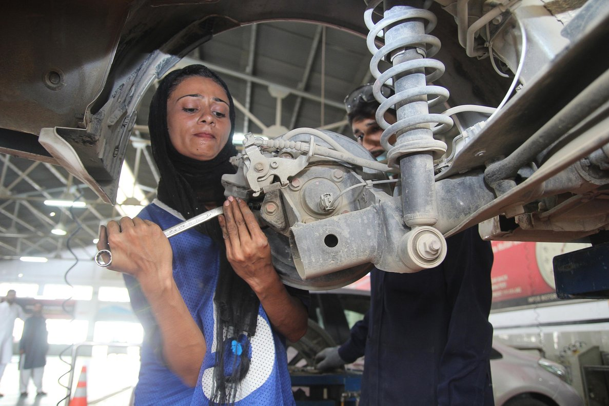 Pakistani motor mechanic Uzma Nawaz  24  fixes a car at an auto workshop in Multan  - Since picking up a wrench as one of the first female car mechanics in conservative Pakistan  Uzma Nawaz has faced two common reactions  shock and surprise  And then a bit of respect   Photo by S S  Mirza   AFP
