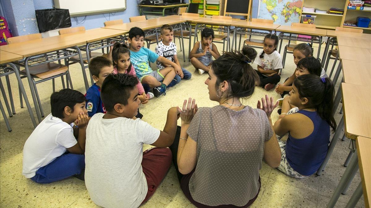 Vuelta al colegio tras las vacaciones estivales. En la imagen la escuela El Til.ler de Barcelona.