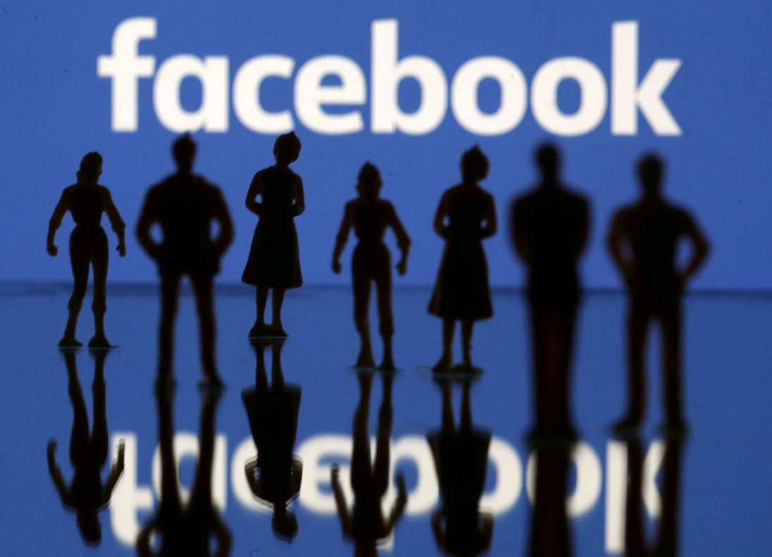 FILE PHOTO Small toy figures are seen in front of Facebook logo in this illustration picture April 8 2019 REUTERS Dado Ruvic File Photo