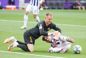 Kike Perez of Real Valladolid and Marc-Andre Ter Stegen of FC Barcelona fight for the ball during the spanish league, La Liga, football match played between Real Valladolid and FC Barcelona at Jose Zorrilla Stadium on July 11, 2020 in Valladolid, Spain.